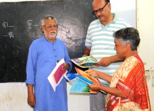 Presenting Our textbooks to DC Rayagada During his visit to Agragamee School